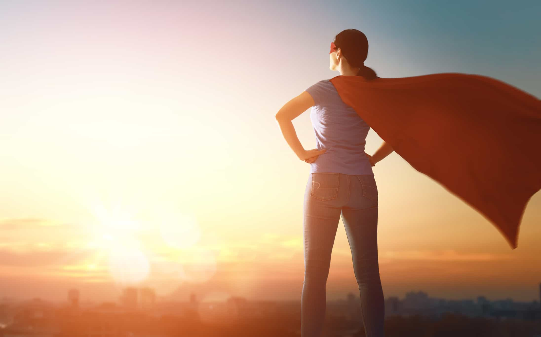 Woman superhero looking out across the cityscape