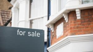For Sale signs displayed outside terraced houses